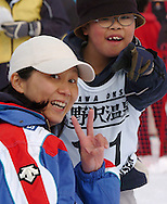 n/z.: Mlody sportowiec Ueno Koyomi (R) Japonia - Olimpiady Specjalne Igrzyska Zimowe podczas zawodow w Olympic Sports Park w Nozawaonsen - Japonia , Nagano , 28-02-2005 , fot.: Adam Nurkiewicz / mediasport..Young athlete Ueno Koyomi (R) Japan - Special Olympics Winter Games during snowshoeing competition at Olympic Sports Park in Nozawaonsen - February 28, 2005 , Japan , Nagano ( Photo by Adam Nurkiewicz / mediasport )