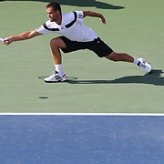 Mikhail Youzhny, Russia, in action against Lleyton Hewitt, Australia, during the Men's Singles competition at the US Open. Flushing. New York, USA. 3rd September 2013. Photo Tim Clayton