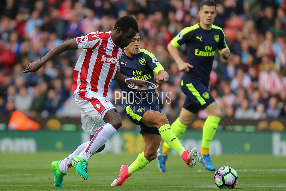 Arsenal forward Alexis Sanchez wins the ball during the Premier League match between Stoke City and Arsenal at the Bet365 Stadium, Stoke-on-Trent, England on 13 May 2017. Photo by Aaron  Lupton.
