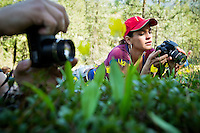 Marily Wenner checks the display on the back of her camera Monday after capturing some wildflower photos on Tubb's Hill with her introductory photography class from North Idaho College.