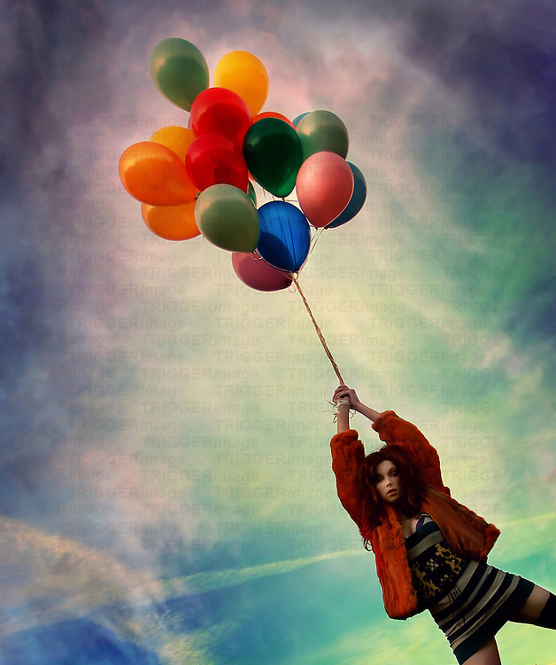 A young woman holding balloons