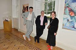 "Left to right. artist MATTHEW STONE, SIR NORMAN ROSENTHAL and SHONAGH MARSHALL curator of the exhibition at a private view of work by Matthew Stone ""Healing The Wounds' held at Somerset House, The Strand, London on 4th July 2016."