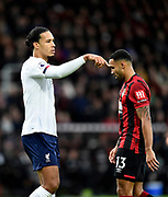 Virgil van Dijk (4) of Liverpool finger looks as if it is pressed against the forehead of Callum Wilson (13) of AFC Bournemouth during the Premier League match between Bournemouth and Liverpool at the Vitality Stadium, Bournemouth, England on 7 December 2019.