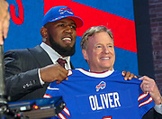 Apr 25, 2019; Nashville, TN, USA; Houston defensive tackle Ed Oliver poses with NFL commissioner Roger Goodell after being selected as the No. 9 pick of the first round by the Buffalo Bills during the 2019 NFL Draft. (Kim Hukari/Image of Sport)
