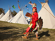 Member of the Confederated Tribes, in dance regalia preparing for the afternoon Indian Show at the Pendleton Roundup. The Pendleton RoundUp is the largest outdoor rodeo in the world,
