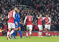 Football - 2017 / 2018 Premier League - Arsenal vs. Everton<br /> <br /> Aaron Ramsey (Arsenal FC) runs to Henrikh Mikhitaryan (Arsenal FC) and Alex Iwobi (Arsenal FC) who provided the assist for his goal at The Emirates.<br /> <br /> COLORSPORT/DANIEL BEARHAM