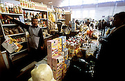 Oyuna Lhakamsuren tends to the shopping at the large covered municipal market in Ulaanbaatar for a weeks' worth of food for her family's upcoming photo shoot. (Supporting image from the project Hungry Planet: What the World Eats.)