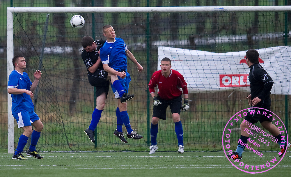 Special Olympics Pomorskie (black) district competes with Special Olympics Warminsko-Mazurskie district (blue) in final of Polish Soccer Tournament Unified of Special Olympics in Mietne on April 28, 2013.The idea of Special Olympics is that, with appropriate motivation and guidance, each person with intellectual disabilities can train, enjoy and benefit from participation in individual and team competitions...Poland, Mietne, April 28, 2013..Picture also available in RAW (NEF) or TIFF format on special request...For editorial use only. Any commercial or promotional use requires permission...Mandatory credit: Photo by © Adam Nurkiewicz / Mediasport
