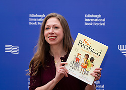 "Edinburgh, Scotland, UK; 19  August, 2018. Pictured; Chelsea Clinton with book for children,  ""She Persisted Around the World."