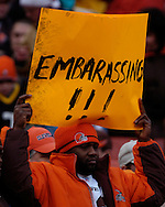 A fan in the stands holds a sign above his head while watching Cleveland fall to Pittsburgh 41-0.