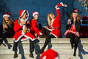 Santa costumes, beer, champagne and sunshine. The annual Santacon walk starts from three locations around london and converges on Hyde Park.Here with the South route starting on Clapham Common ebventuaully making a stop at Buckingham Palace and the Mall.