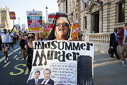 London, June 21st 2017. Protesters march through London from Sheherd's Bush Green in what the organisers call 'A Day Of Rage' in the wake of the Grenfell Tower fire disaster. The march is organised by the Movement for Justice By Any Means Necessary and coincides with the Queen's Speech at Parliament, the destination. PICTURED: The last few protesters march towards Downing Street from Parliament Square.