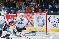 KELOWNA, CANADA - JANUARY 08: Michael Herringer #30 of Kelowna Rockets keeps his eye on an airborne puck against the Everett Silvertips on January 8, 2016 at Prospera Place in Kelowna, British Columbia, Canada.  (Photo by Marissa Baecker/Shoot the Breeze)  *** Local Caption *** Michael Herringer;
