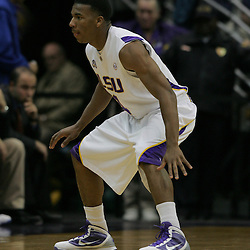 Jan 04, 2010; Baton Rouge, LA, USA; LSU Tigers guard Chris Bass (4) controls on defense during a game against the McNeese State Cowboys at the Pete Maravich Assembly Center. LSU defeated McNeese State 83-60.  Mandatory Credit: Derick E. Hingle-US PRESSWIRE