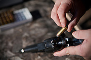 John Daniel Shannon, 48, a former US Army Senior Sniper, is loading his .44 Magnum in a range near his home in Westcliffe, CO, USA, where he retired with his family after a serious brain injury inflicted by an insurgent sniper in Ramadi, Al Anbar Province, Iraq, on November 13th 2004. Daniel fought during the Second Battle of Fallujah and was then moved to nearby Ramadi. Daniel lost his left eye and has multiple health issues because of his injury: memory problems, balance problems, he can't smell and taste well anymore, he suffers from PTSD, has  troubles with large crowds and city surroundings. This is the reason why he and his family moved to a quiet location on the Rocky Mountains. In 2007 Dan helped the Washington Post to uncover patients' neglect at the Walter Reed Army Medical Center; he also testified before Congress. Torrey, 42, his wife, is a freelance writer and a contributor for the Huffington Post; she's also campaigning to improve the situation of veterans' families.