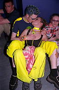 Two kissing clubbers in bright yellow outfits, Passion, Emporium, Milton Keynes, UK, 2002