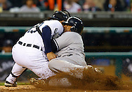 May 03, 2011; Detroit, MI, USA; Detroit Tigers catcher Alex Avila (13) tags New York Yankees center fielder Andruw Jones (18) out at home plate during the fourth inning at Comerica Park.