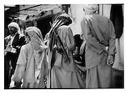 4..Tribesmen examine weapons at the gunrunners? suq near Saudi border, Suq al Talh, Sadah Governate.