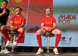 LIVERPOOL, ENGLAND - Monday, May 9, 2016: Liverpool's Philippe Coutinho Correia and Jordan Henderson at the launch of the New Balance 2016/17 Liverpool FC kit at a live event in front of supporters at the Royal Liver Building on Liverpool's historic World Heritage waterfront. (Pic by Lexie Lin/Propaganda)