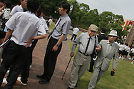 Akira Iwanaga (on right) and Tsutomu Yamaguchi (on left), walk amongst school children, during a visit to the Epicentre Park marking the epicentre of the Nagasaki Atomic bombing blast on 9th August 1945.  Picture taken in Nagasaki, Japan, Tuesday May 24th 2005. Both men were in Hiroshima on the day of the first atomic bombing, 6th Aug. 1945, and also in Nagasaki three days laeter on the day of the second atomic bombing of Japan by US Military.