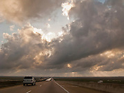 crossing the Pascagoula River on interstate 10 in Mississippi with a cloud-filled sky.