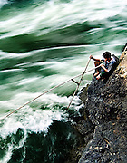 A fisherman trying his luck at Tat Somphamit (rapids) on Don Khone (Island), Laos.