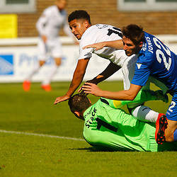Dovers forward Jamie Allen falls to the floor with Eastleighs midfielder Joe Jones and Eastleighs keeper Graham Stack as the ball goes just wide during the National League match between Dover Athletic FC and Eastleigh FC at Crabble Stadium, Kent on 25 August 2018. Photo by Matt Bristow.