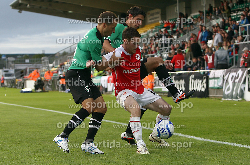 Europa League Third Qualifying Round 1st Leg, Dublin 2/8/2012.St. Patrick's Athletic vs Hannover 96.John Russell of Pats with Steven Cherundolo and Lars Stindl of Hannover. *** Local Caption *** © pixathlon