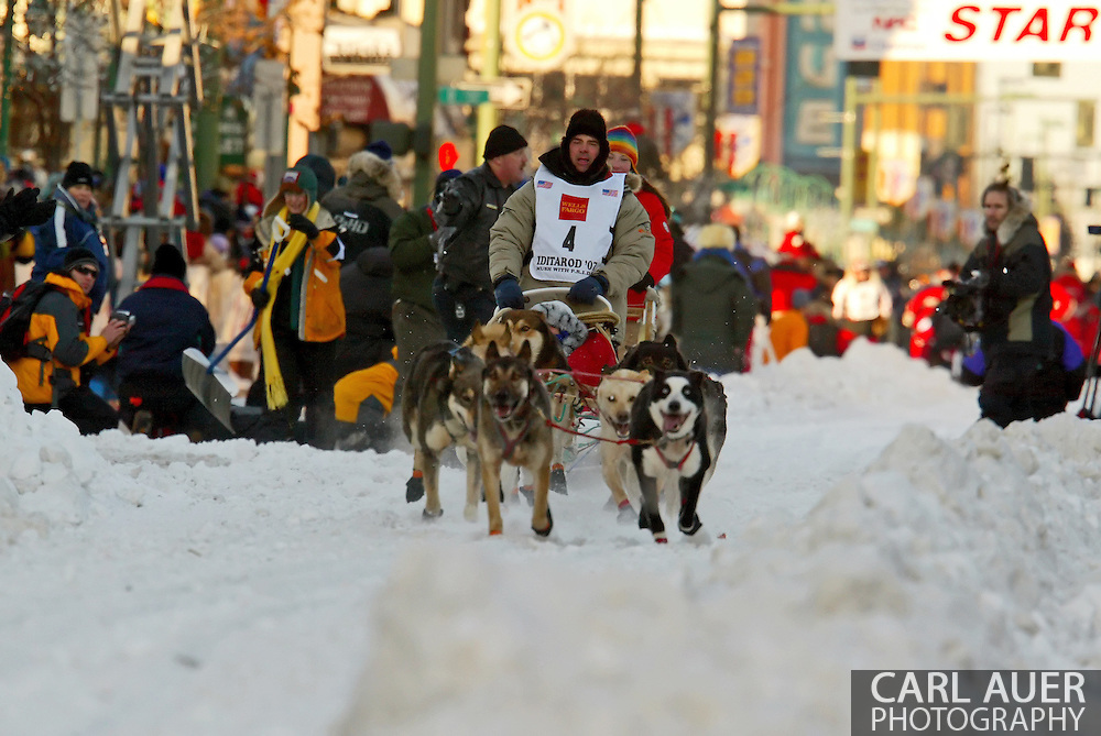 3/3/2007:  Anchorage Alaska -  The team of Veteran Cim Smyth of Big Lake, AK heads down 4th Avenue in Anchorage for the start of the 35th Iditarod Sled Dog Race