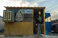 Barber shop<br /> 17 year-old Mnaan Hani has been living in the Christian refugee camp in Ankawa, Erbil since 2014. He fled his home city of Qaraqosh because of the Islamic State's advance in August, 2014. Hani lives with his family in a container home in the back or the barber shop. He learned his profession in Qaraqosh and in the camp has around ten clients a day. He spent 3 million dinar (2,500 US dollars) to build the shop. He plans to migrate to Australia in the next four years.