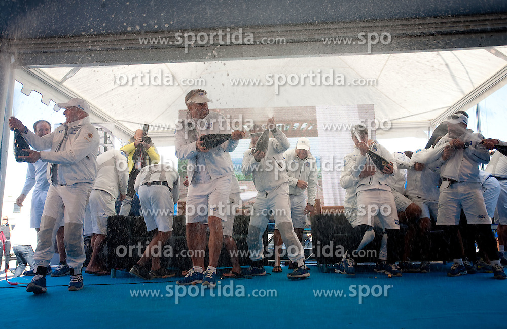 Celebration of Winning boat Esimit Europa 2 owned by Igor Simcic of Slovenia (L) and skippered by Jochen Schumann of Germany (C) during Barcolana 43 sailing regatta hosted by Societa Velica di Barcola e Grignano on October 9, 2011, in Trst / Trieste Gulf, Italy.   (Photo by Vid Ponikvar / Sportida)