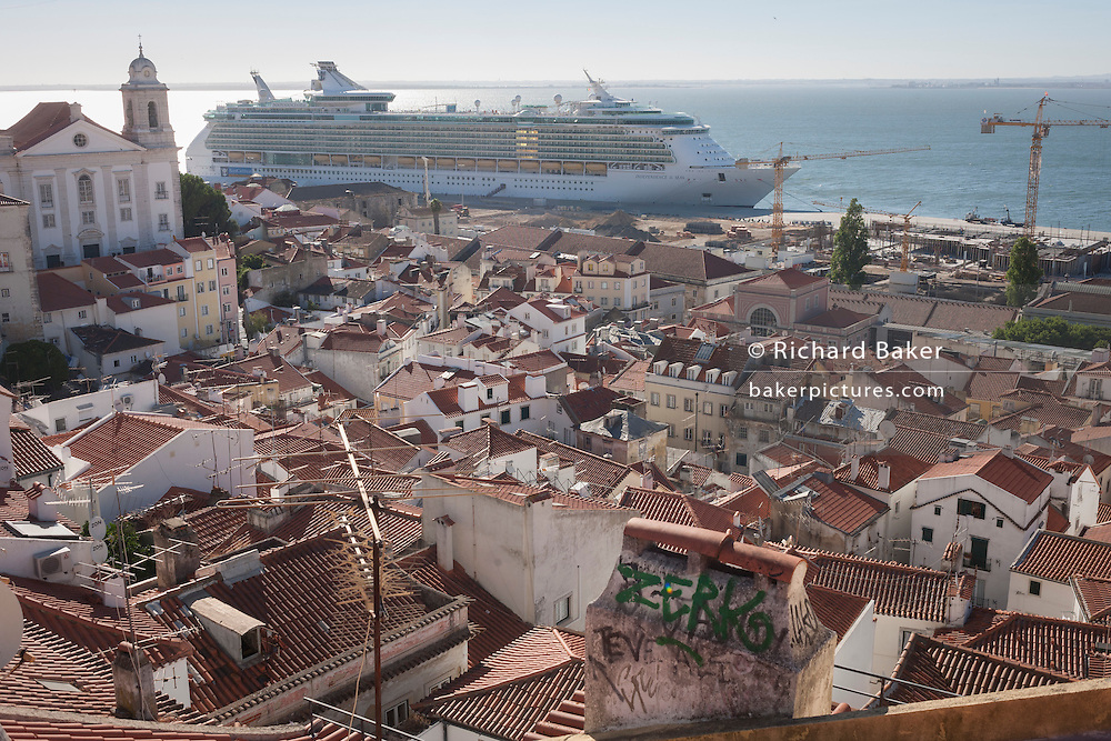The 'Independence of the Seas' cruise liner dominates the medieval district of Alfama, in Lisbon, Portugal. MS Independence of the Seas is a Freedom-class cruise ship operated by the Royal Caribbean cruise line which entered service in April 2008. The 15-deck ship can accommodate 4,370 passengers and is served by 1,360 crew.
