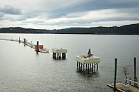 JEROME A. POLLOS/Press..Two supports structures at the entrance of The Coeur d'Alene Resort boat slips stand bare and awaiting the reattachment of the bridge that crossed the water way. The bridge is currently undergoing a maintenance overhaul, but the boardwalk is still open to the public with access at the east-side entrance.