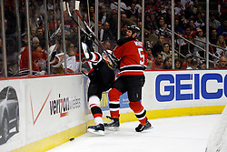 April 28, 2007; East Rutherford, NJ, USA; New Jersey Devils defenseman Colin White (5) delivers a hit during the second period of game two of the 2007 NHL Eastern Conference semi-finals at Continental Airlines Arena in East Rutherford, NJ.