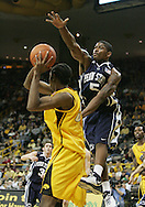 24 JANUARY 2007: Penn State guard/forward Geary Claxton (5) tries to block a shot by Iowa forward Kurt Looby (52) in Iowa's 79-63 win over Penn State at Carver-Hawkeye Arena in Iowa City, Iowa on January 24, 2007.