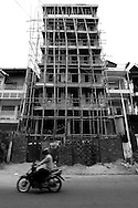 Bamboo scaffolding covers a building during its construction, Phnom Penh, Cambodia, Southeast Asia
