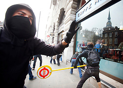 © under license to London News Pictures.  26/03/11 Anarchists attack Cafe Nero on Piccadilly at the massive Anti-cuts march in London. Photo credit should read: Olivia Harris/ London News Pictures