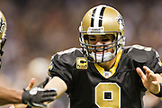 NEW ORLEANS, LA - DECEMBER 26:   Drew Brees #9 of the New Orleans Saints celebrates after throwing a touchdown pass against the Atlanta Falcons at Mercedes-Benz Superdome on December 26, 2011 in New Orleans, Louisiana.  The Saints defeated the Falcons 45-16.  (Photo by Wesley Hitt/Getty Images) *** Local Caption *** Drew Brees