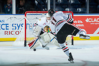 KELOWNA, CANADA - OCTOBER 21:  Bronson Sharp #11 of the Portland Winterhawks warms up with a shot on net against the Kelowna Rockets on October 21, 2017 at Prospera Place in Kelowna, British Columbia, Canada.  (Photo by Marissa Baecker/Shoot the Breeze)  *** Local Caption ***