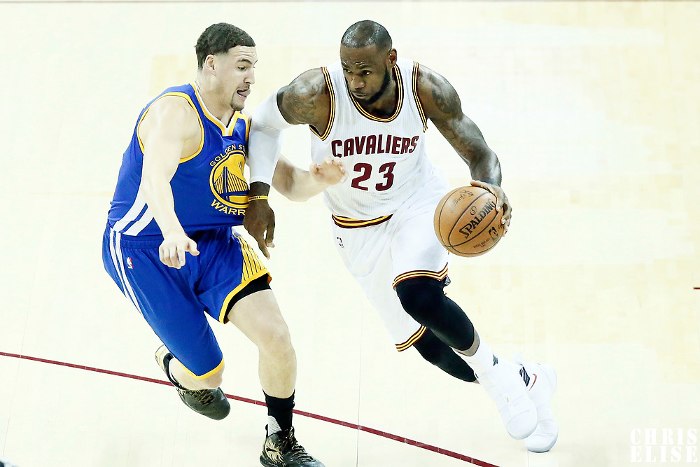 07 June 2017: Cleveland Cavaliers forward LeBron James (23) drives past Golden State Warriors guard Klay Thompson (11) during the Golden State Warriors 118-113 victory over the Cleveland Cavaliers, in game 3 of the 2017 NBA Finals, at  the Quicken Loans Arena, Cleveland, Ohio, USA.