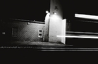 Night train passes through town behind firehouse in Gaithersburg, Maryland.  Copyright 2008 Reid McNally.