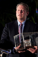 Al Gore, winner of the inaugural Roger Revelle Prize, accepts a jarred sample of mud from Tony Haymet, director of the Scripps Institution of Oceanography on March 6, 2009.  Revelle collected the mud during some of his early research.  Members of the Revelle family appeared on stage with Gore.