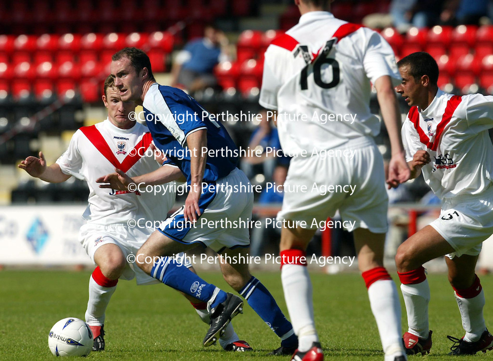 Airdrie v St Johnstone...07.08.04<br />Michael Moore is surrounded by Airdire players, Marvyn Wilson, Alan McManus and Scott Wilson<br /><br />Picture by Graeme Hart.<br />Copyright Perthshire Picture Agency<br />Tel: 01738 623350  Mobile: 07990 594431