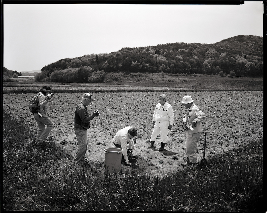 Taking samples of Radioactive soil form  Katsuzo Shoiji's rice field Levels of more then 10  micro sieverts are still present more than 60 days after the  march 15 explosions and fire at  Daiichi Nuclear power plants 40km away<br /> <br />  Katsuzo Shoji's (75) family has worked   this land for  more then 6 generations Like the rest of the town's population  he is being forced to evacuate most likely to an apartment 20km away.  uncertain when he will be able to return he has been able to rent some land to continue his work  outside of the  heavily  contaminated village.  the  Fukushima Daiichi nuclear power plant, about 40km away.  Outside the 20km government exclusion zone, the village&rsquo;s mountainous topography  funneled radiation spewing from its crippled reactors trapping it there, poisoning crops , water and livestock.  he has  been told  he must  destroy his crops and  his six prized  Iitate beef cows must be killed.