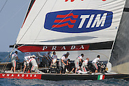 Italy's team Luna Rossa team trims sails after rounding mark and switching from spinnaker to genoa during America's Cup fleet race; Valencia, Spain.