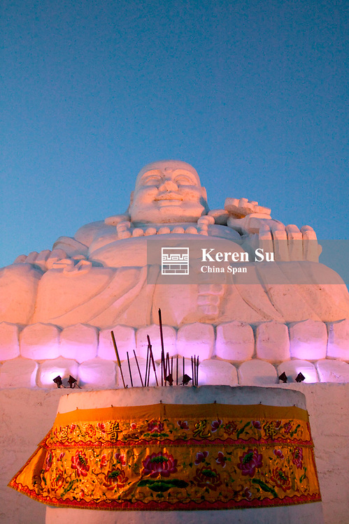 Illuminated snow sculpture of Laughing Buddha, Harbin, Heilongjiang Province, China