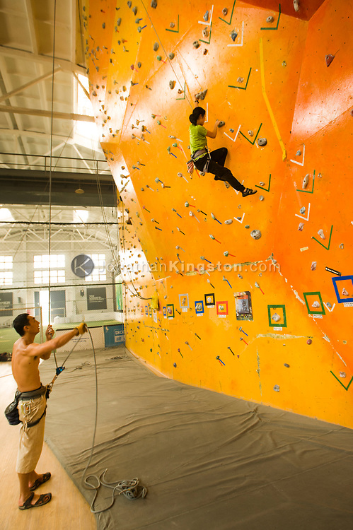 Two rock climbers work out in a climbing gym in Beijing, China (Model Released, Sean Ouyang, Rachel Ouyang).