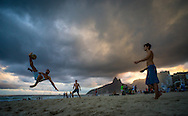Three young men play football on Ipanema beach at sunset in Rio de Janeiro, Brazil. Picture by Andrew Tobin/Focus Images Ltd +44 7710 761829<br /> 27/06/2014