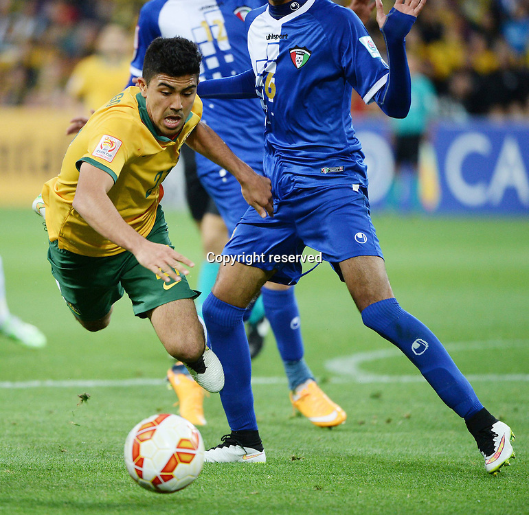 09.01.2015. Melbourne, Australia.  Massimo Luongo (L) of Australia chases the ball during the opening football match against Kuwait at the AFC Asian Cup in Melbourne, Australia, January 9, 2015. Australia won 4-1.