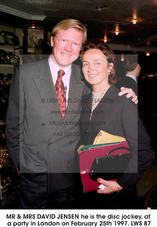 MR & MRS DAVID JENSEN he is the disc jockey, at a party in London on February 25th 1997.LWS 87